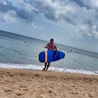 Photo taken at Pantai Kuta (Kuta Beach) by konst on 6/12/2013