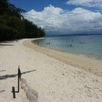 Photo taken at Manukan Island by Nicholas L. on 10/26/2012