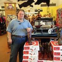 Photo taken at Ray's Sports & Western Wear by Susie B. on 8/26/2013