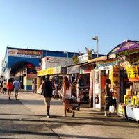 Photo taken at Venice Beach Boardwalk by Miguel F. on 10/5/2012
