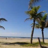 Photo taken at Praia do Sesc Bertioga by Caah R. on 3/17/2014