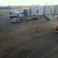 Photo taken at Gate E14 by Kevin M. on 10/4/2012