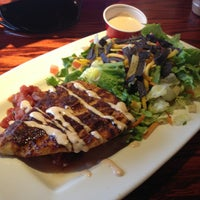 Photo taken at Red Robin Gourmet Burgers by Angela S. on 1/10/2013