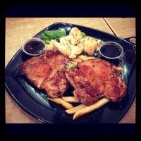 Photo taken at Cafe Indulge by Lambert H. on 11/12/2012