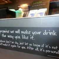 Photo taken at Starbucks by Dudsadee A. on 1/30/2013