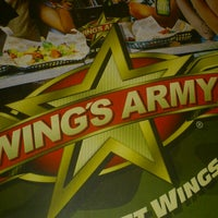 Photo taken at Wings Army by Contreras R. on 3/29/2013