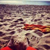 Photo taken at Makaha Beach Park by Maximilian on 12/30/2012