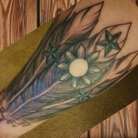 Photo taken at Artful Dodger Tattoo by Beau S. on 2/10/2015
