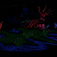 Photo taken at Putting Edge Glow-in-the-Dark Mini Golf by Zach Y. on 4/6/2013