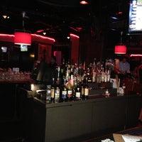 Photo taken at Iris Lounge by Christy J. on 4/13/2013