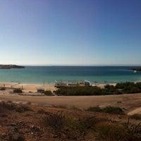 Photo taken at Playa Pichilingue by abrahamnm on 1/6/2013