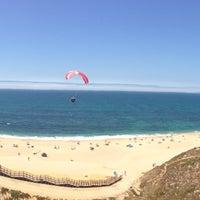 Photo taken at Praia das Bicas by Vasco C. on 7/22/2013