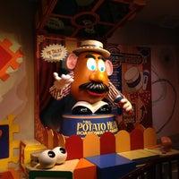 Photo taken at Toy Story Mania! by Seba C. on 3/8/2013