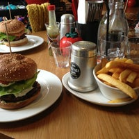 Photo taken at Gourmet Burger Kitchen by Caty G. on 3/31/2013