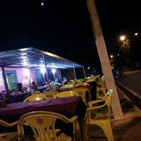 Photo taken at Millenium Pizzaria e Esfiharia by Junior B. on 9/26/2012