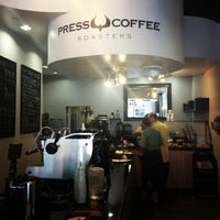 Photo taken at Press Coffee Roasters by Lauren H. on 3/21/2013