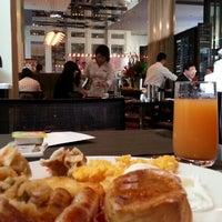 Photo taken at Glass Brasserie by Ricky S. on 9/18/2012