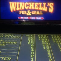 Photo taken at Winchell's Pub & Grill by Thomas D. on 12/10/2013
