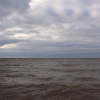 Photo taken at Lake Erie by leo k. on 3/23/2014
