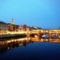 Photo taken at Ponte Vecchio by Elizabeth S. on 7/21/2013