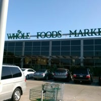 Photo taken at Whole Foods Market by Juan C G. on 12/8/2012