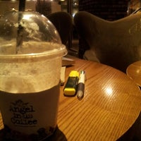 Photo taken at Angel-in-us Coffee by Miri P. on 10/13/2012