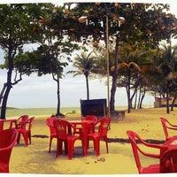 Photo taken at Praia de Itaparica by Genevieve V. on 11/17/2012