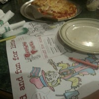 Photo taken at Beggars Pizza by Christopher H. on 3/2/2013