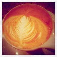 Photo taken at Atomic Coffee by Matt F. on 12/8/2012