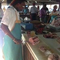 Photo taken at Oistins Fish Market by Kathryn A. on 3/26/2013