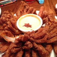 Photo taken at Outback Steakhouse by Julianne K. on 12/23/2012