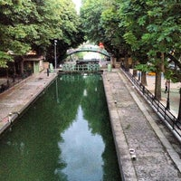 Photo taken at Canal Saint-Martin by Damaris B. on 8/12/2013