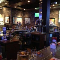 Photo taken at Champps Restaurant & Bar by Chetan U. on 2/5/2013