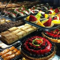 Photo taken at Porto's Bakery & Cafe by Mr. D. on 6/10/2012