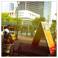 Photo taken at Atlantic Station Central Lawn by Nick J. on 7/27/2011