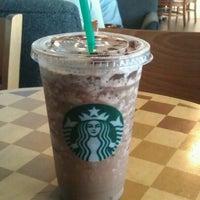 Photo taken at Starbucks by Nil R. on 3/14/2012