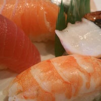 Photo taken at Cafe Sushi by David M. on 9/11/2012