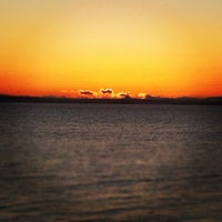 Photo taken at Crescent Beach by Sarah S. on 10/31/2011