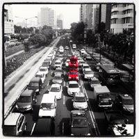 Photo taken at Jalan Jenderal Sudirman by thomas f. on 11/30/2011