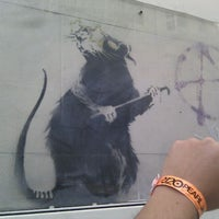 Photo taken at Banksy Mural: 'Glitter Glasses' Rat by Manu G. on 10/24/2011