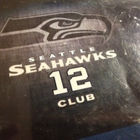 Photo taken at Seattle Seahawks 12 Club by Leslie L. on 4/21/2012