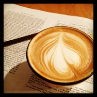 Photo taken at Small World Coffee by Flori P. on 3/2/2012