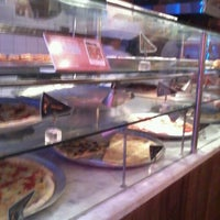 Photo taken at O Pedaço da Pizza by toniolo n. on 11/23/2012