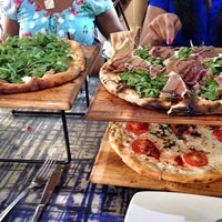 Photo taken at Urban Crust Wood Fired Pizza by Faith H. on 10/2/2013