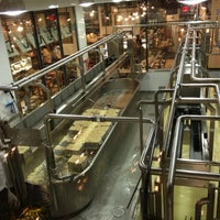 Photo taken at Beecher's Handmade Cheese by Caitlin J. on 11/24/2012