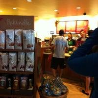 Photo taken at Starbucks by Yuri S. on 12/24/2012