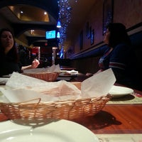 Photo taken at Gino's Pizzeria & Restaurant by David D. on 12/28/2013
