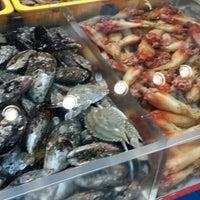 Photo taken at Jagalchi Fish Market by Jaeha P. on 7/28/2013