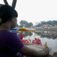 Photo taken at Danau perum Alamanda regency by Tri P. on 2/8/2013