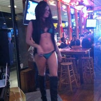 Photo taken at Hooters of Princeton by Claire P. on 12/14/2012